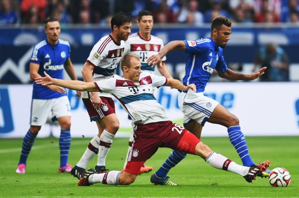 GELSENKIRCHEN, GERMANY - AUGUST 30: Holger Badstuber of FC Bayern Muenchen challenges Eric Maxim Choupo-Moting of FC Schalke 04 during the Bundesliga match between FC Schalke 04 and FC Bayern Muenchen at Veltins Arena on August 30, 2014 in Gelsenkirchen, Germany. (Photo by Dennis Grombkowski/Bongarts/Getty Images)