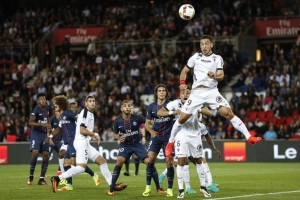 Metz's Melvut Erding goes for a high ball during the French League One soccer match between PSG and Metz at the Parc des Princes stadium in Paris, France, Sunday, Aug. 21, 2016. (AP Photo/Kamil Zihnioglu)