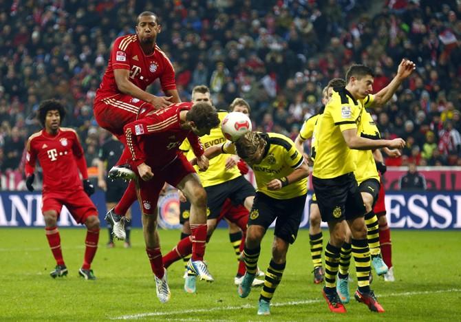 Boateng and Mueller of Bayern Munich attempt to score during their German first division Bundesliga soccer match against Borussia Dortmund in Munich